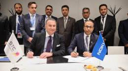 Samih Elhage of Nokia (left) and Nasser Al-Nasser of STC (right) sign MoU