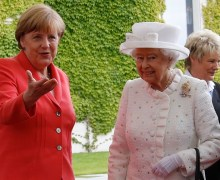 Britain's Queen Elizabeth is greeted by German Chancellor Angela Merkel at the Chancellery in Berlin