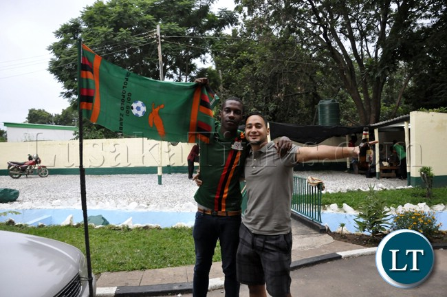 A couple of soccer fans captured in a high  mood before the Zambia Bukina Faso match in Lusaka