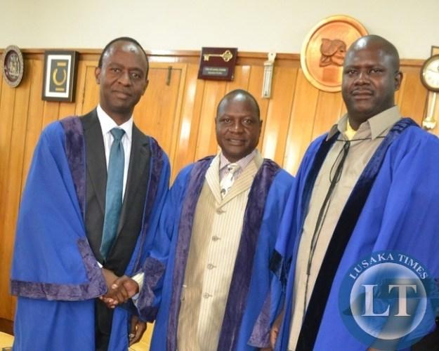 Former Lusaka Mayor Mulenga Sata (l) Newly elected Lusaka Mayor George Nyendwa (C) and Former Lusaka Mayor Danial Chisenga at Lusaka's Civic Centre after the mayoral elections