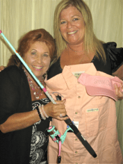 Lynn F. Casella shows off her newly won fishing rod to her sister Debbie Hammond.
