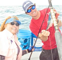Lynn enjoys her first catch of the day on Carib Sea off Islamorada.