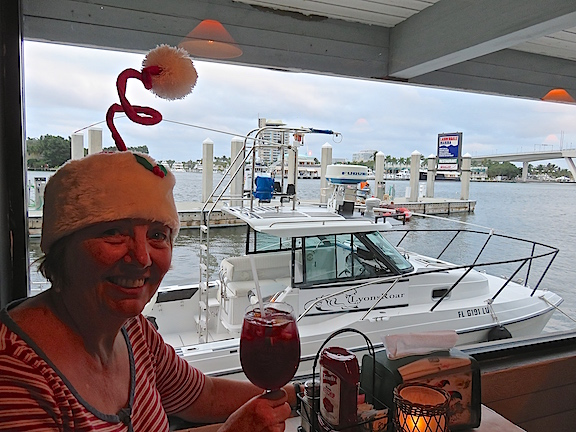 Karen enjoys a glass of Christmas cheer with a view of the 17th Street Causeway at 15th St. Fisheries.