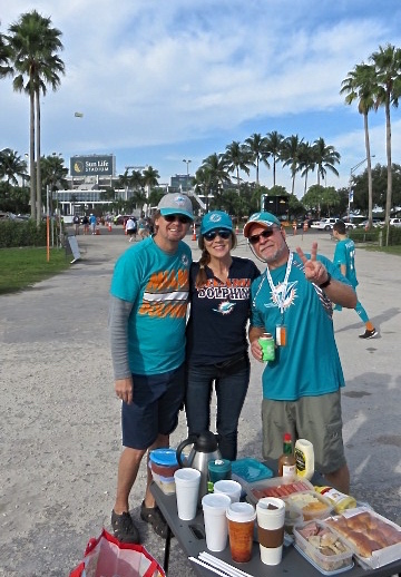 Karen shoots Mike, Amy and Jeff at the last Dolphins' tailgate party of the 2015-16 Season.