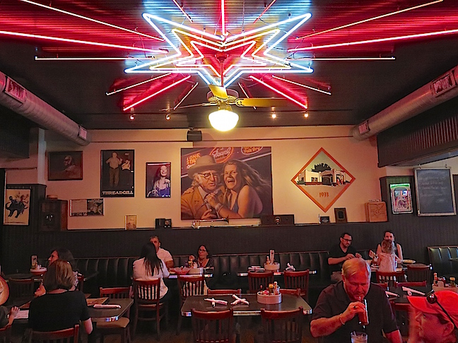 "Regulars at hootenannies on Wednesday nights were Janis Joplin, Eddie Wilson and Willie Nelson. Their blend of country, rock, and blues birthed the ""Cosmic Cowboy"" sound."