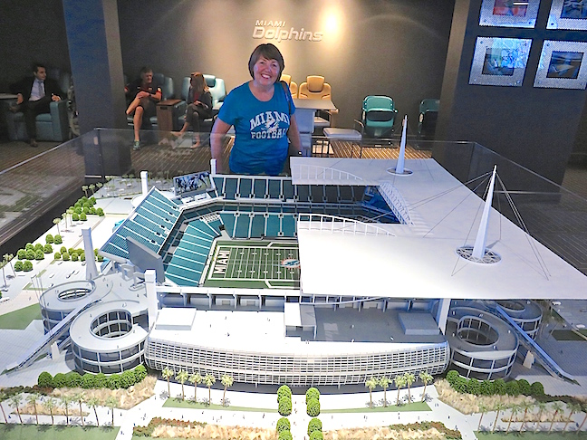 Karen inspects the stadium model during our tour of the cool new lounges and indoor, elite hang outs.