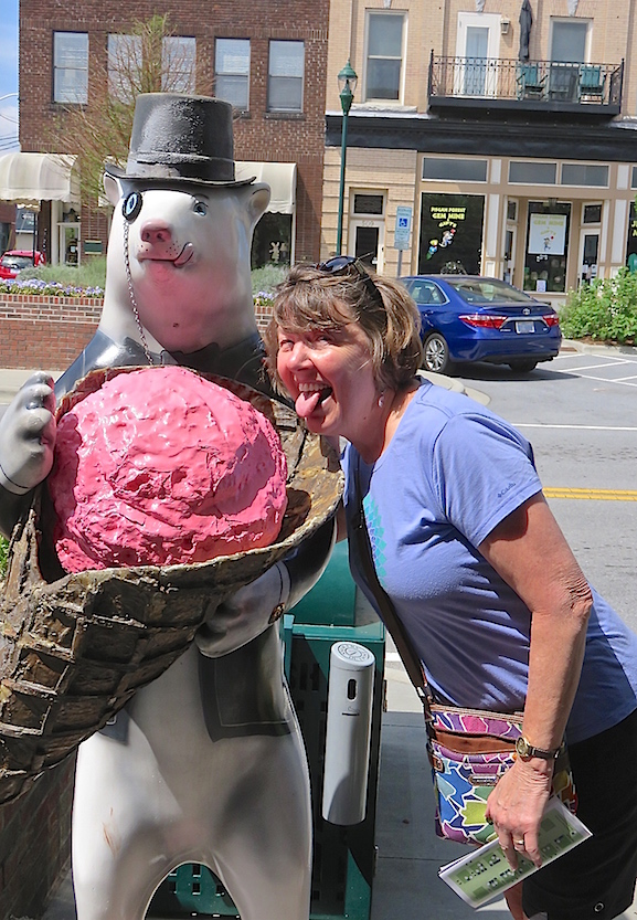 Karen shares ice cream with a bear in Hendersonville, NC.