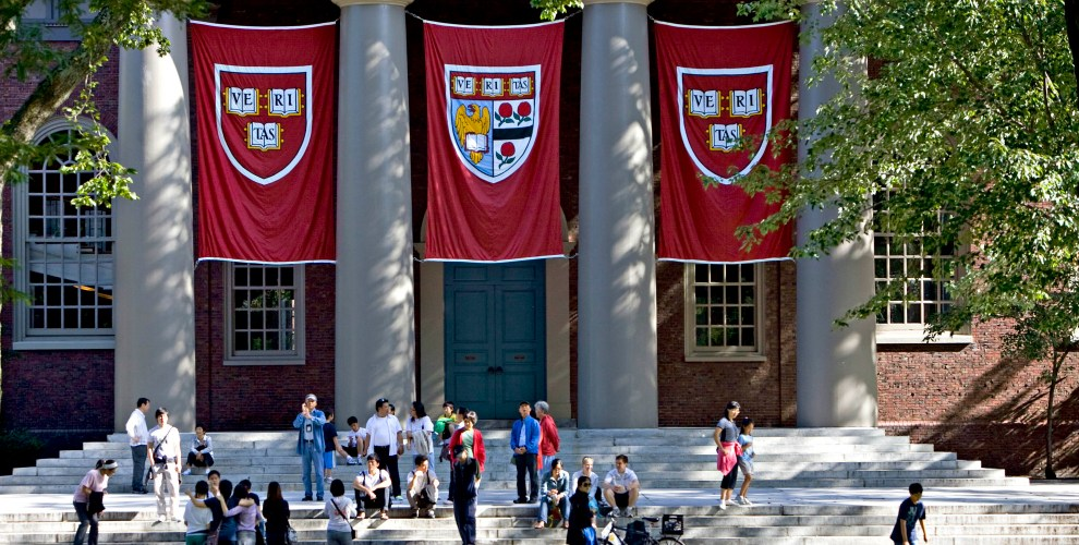 UNITED STATES - SEPTEMBER 03:  Harvard banners hang outside Memorial Church on the Harvard University campus in Cambridge, Massachusetts, U.S., on Friday, Sept. 4, 2009. Community activists in Allston, a section of Boston across the Charles River from Harvard's main campus in Cambridge, say university delays have left a  (Photo by Michael Fein/Bloomberg via Getty Images)