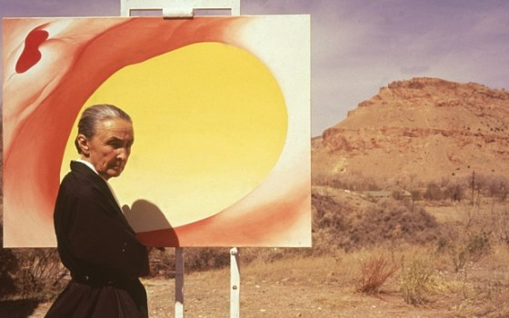 American artist Georgia O'Keeffe (1887 - 1986) poses outdoors beside an easel with a canvas from her series, 'Pelvis Series Red With Yellow,' Albuquerque, New Mexico, 1960. (Photo by Tony Vaccaro/Getty Images)