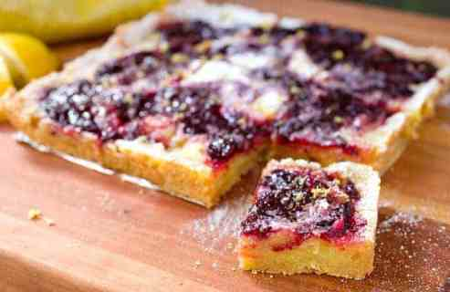 Lemon Cherry Swirl Bars: These simple baked dessert bars are gluten-free and use Bob's Red Mill Almond Flour for the crust! The bars are bright, fruity, tangy, and so very addictive. The recipe uses real lemons and cherries! #spons   macheesmo.com