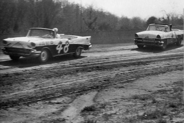 Dirt track 1957 Chevrolet and 1956 Mercury