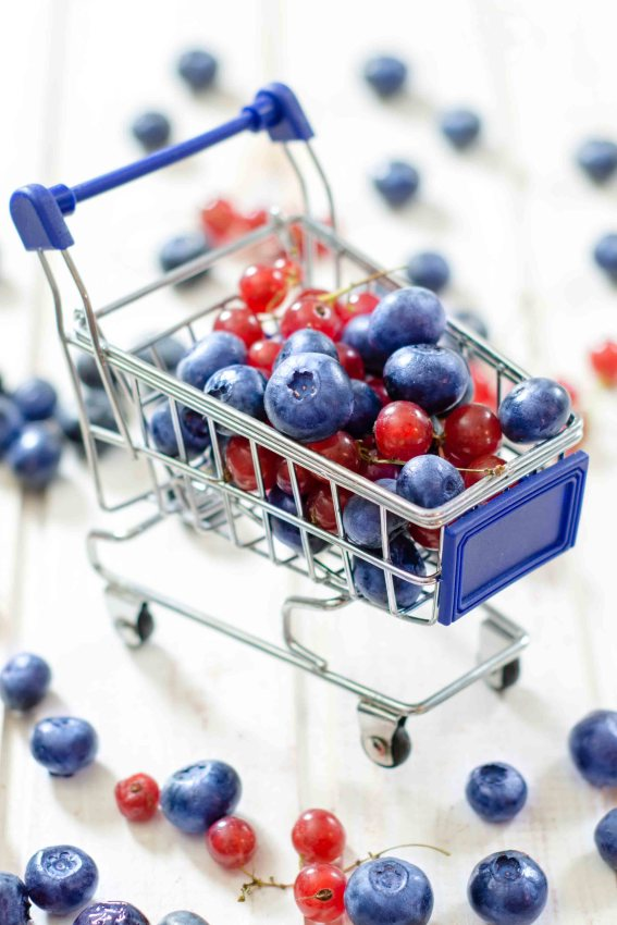 Trolly full with the berry fruit.Selective focus on the front blueberry and currant