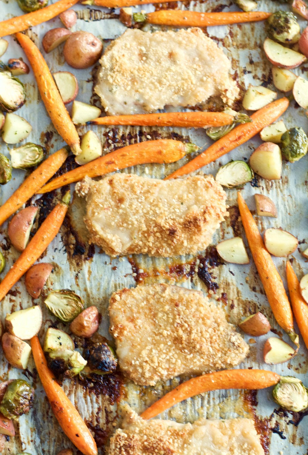 Try these easy One Pan Crispy Pork Chops and Ranch Roasted Veggies for an easy Fall meal ready in just 30 minutes!