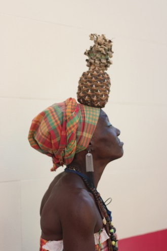 This is what she does for a living: Balances a locally-grown black pineapple on her head. You can take her photo for a dollar. It was worth a dollar.