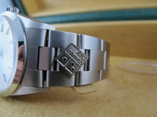 Rolex AK DP Logo bracelet detail