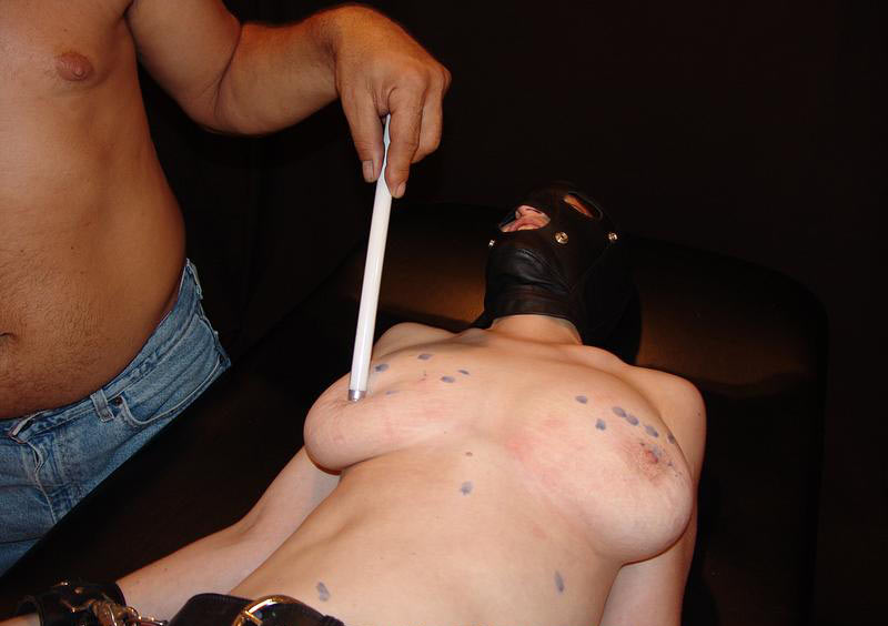 hung by tits torture