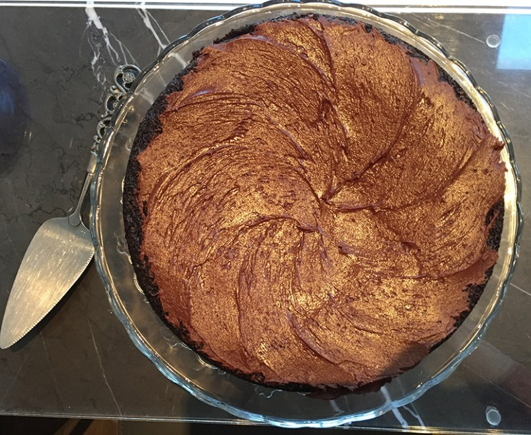 Chocolate cake with coconut and chocolate olive oil water glaze