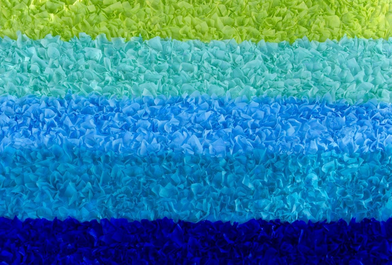 How to make an ombre tissue paper backdrop for a party