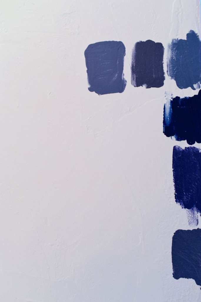 Painting a navy blue accent wall]