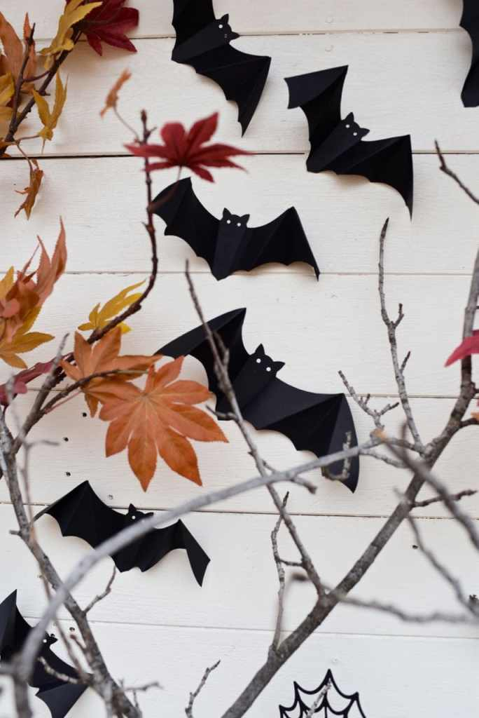 Flying bats decorations for Halloween at a haunted forest Halloween party