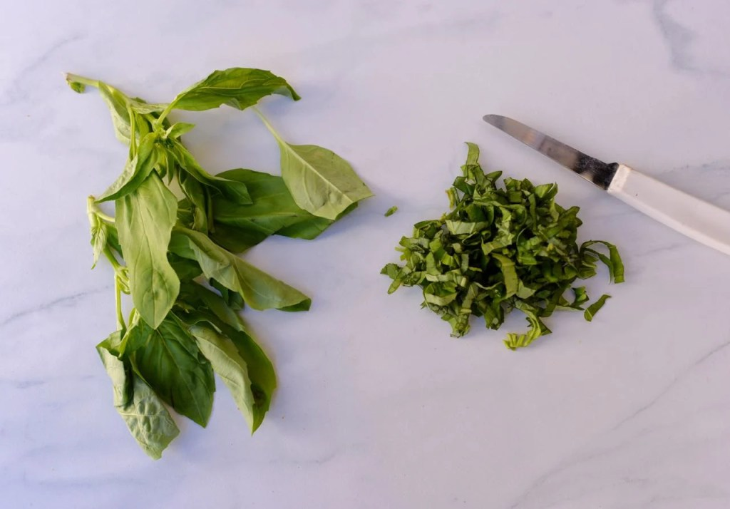 cut fresh basil for homemade marinara sauce