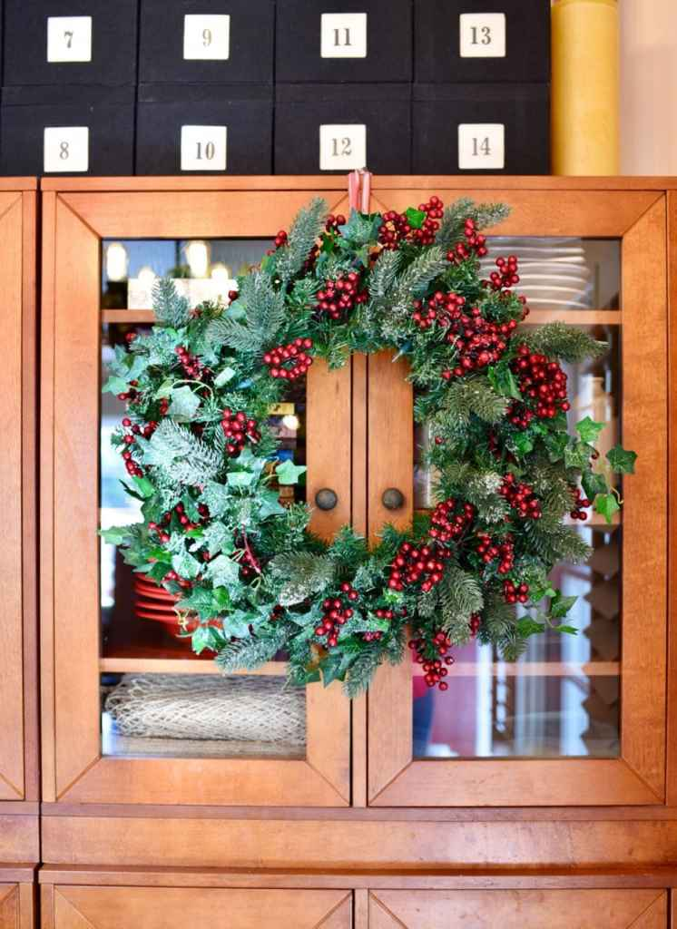 Christmas wreath with berries in Christmas living room
