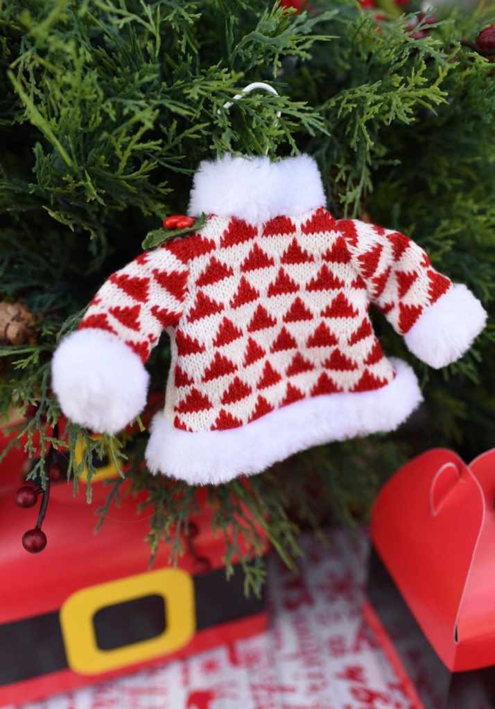 Sweater ornament on Christmas tree for One Warm Coat and Coca-Cola