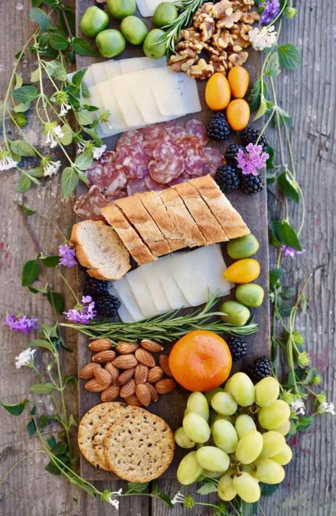 Learn how to easily make a gorgeous charcuterie and cheese plate , perfect for entertaining!