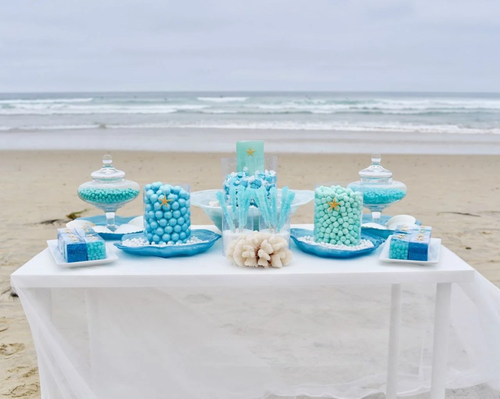 Gorgeous wedding candy buffet with blue, turquoise, and mint candy