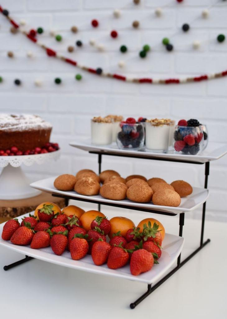 Holiday brunch ideas with fruit, pumpkin bagels, yogurt, and berries