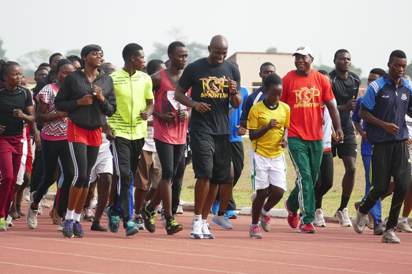 Top Sprinter Coaches Francis Obikwelu and Deji Aliu take the athletes through their paces in warmup on Sunday