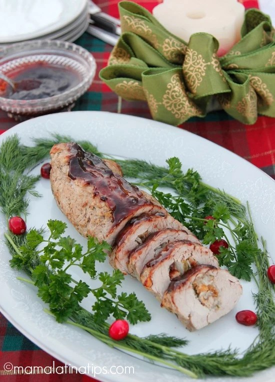 Stuffed Pork Tenderloin with Jerez-Cranberry-Chipotle Sauce - mamalatinatips.com
