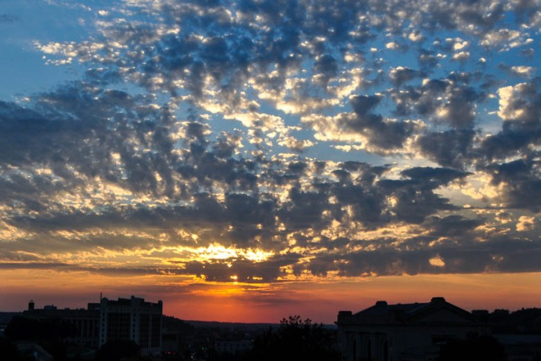 Kansas City-- sunset over Union Station, as photographed from the Sheraton Crown Center pool deck