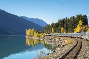 Passenger train along Moose Lake in Jasper National Park, Albeta