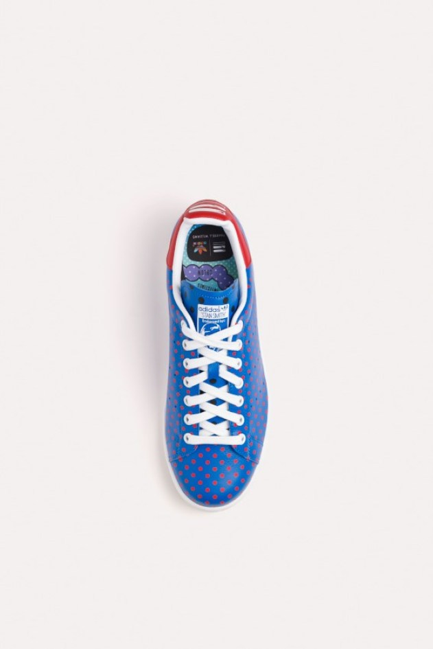 Blue sneakers with red polka dots from adidas X Pharrell Williams collection