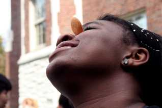 Kendra Ford (11) tries to et the cookie into her mouth from her forehead. Photo by Miracle Stewart