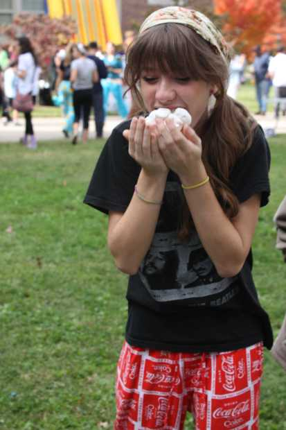 Laura Daley (11) plays Chubby Bunny at the carnival. Photo by Julia Nguyen