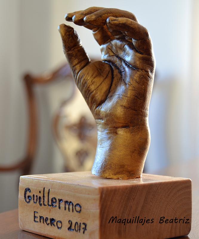 Molde mano niño acabado en bronce