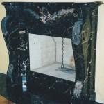 Caminetto in Nero Portoro intarsiato