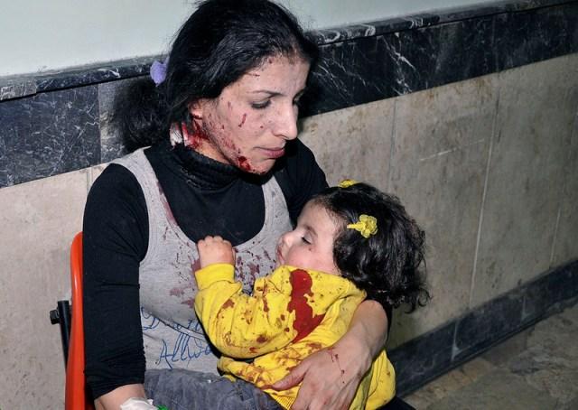 war in Syria Mom child