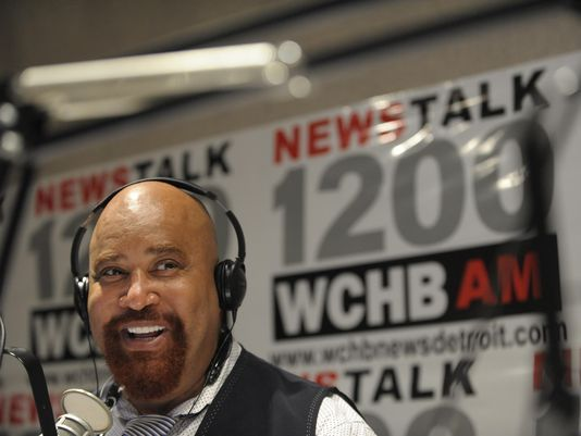 """Detroit Mayoral Candidate Mike Duggan and his guest Impact Church Pastor Keenan Knox, 42, of Detroit, talk with listeners and are interviewed during the Angelo Henderson Show called, """"Your Voice,"""" on NewsTalk 1200 AM and 99.9 FM WCHB, Wednesday morning, October 16, 2013. (Todd McInturf / The Detroit News)2013. (Photo: Todd McInturf / The Detroit News)"""