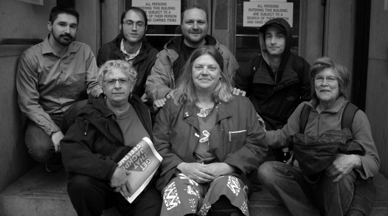 Courtney is surrounded by friends and supporters on the steps of Multnomah County Court house, after her first court date involving her no-cause eviction. Photo by Mary Anne Funk April 12, 2016 Photo by Mary Anne Funk