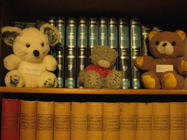 Our toys now, labeled with our names and placed in my granddad's library. (Photo taken by me).