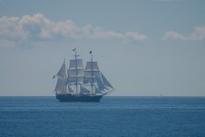 tall ship awash in the mid-day sun