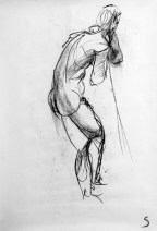 A charcoal life drawing of male model Andres, standing leaning against a pole