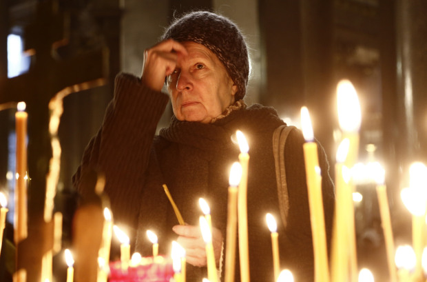 A woman prays as she lights a candle in a church in St.Petersburg during a day of national mourning for the plane crash victims in St. Petersburg, Russia, on Sunday, Nov. 1, 2015. A Russian passenger plane has crashed in the Sinai peninsula Saturday with 217 passengers, mostly Russians, and seven Russian crew members killed. (AP Photo/Dmitry Lovetsky) Postmedia PIX Today ORG XMIT: POS1511010455284930 ORG XMIT: POS1511011346322971