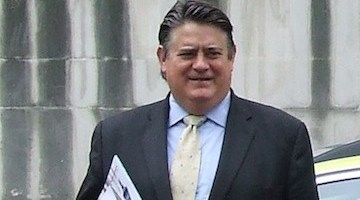 "Mr Greenhalgh is accused of issuing ""misleading"" statements."