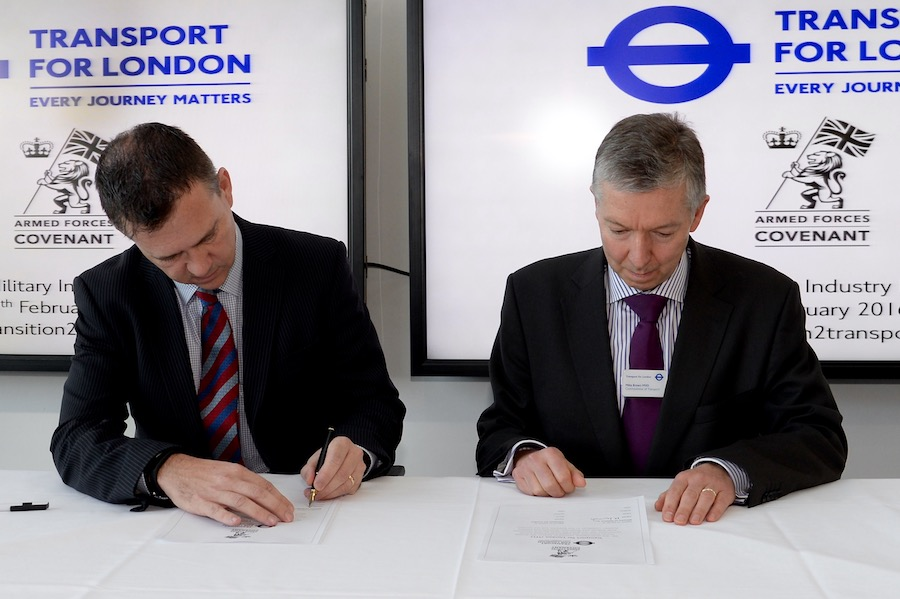 Mark Lancaster and Mike Brown sign the Armed Forces Covenant.