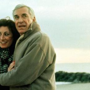CRIMES AND MISDEMEANORS, Anjelica Huston, Martin Landau, 1989, couple at the beach in winter