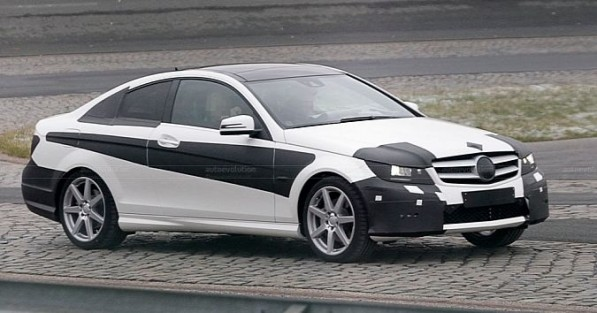 mercedes benz c class coupe spy shot 597x313 Spy shots reveal 2012 C Class Coupe